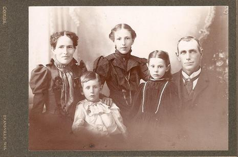 Lydia Rippey (center) along with her family during her first year teaching.